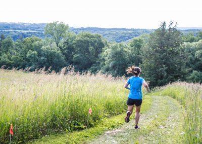 2017 50K Winner Jayna Tomalty Running Campground - Photo Credit Fresh Tracks Media