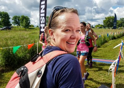 Natalie Working the Finish Line and Having Some Fun - Photo Credit John Storkamp